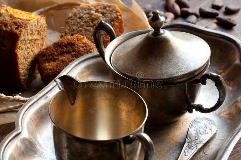 Silver utensil, bread and cocoa royalty free stock photography