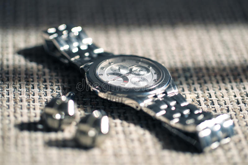 Silver watch. Aluminium on fabric table royalty free stock image