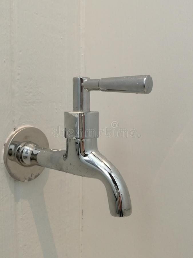 Silver Water Faucet Isolated On White Wood Wall With Blur Background ...