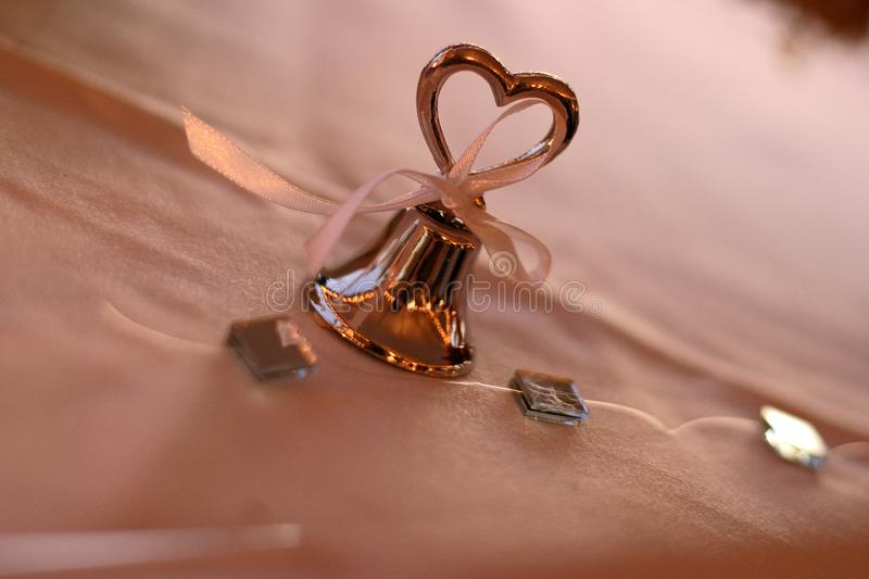 Silver wedding bell with heart royalty free stock images
