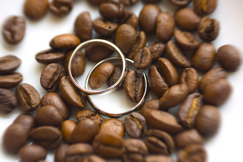 Silver wedding rings on coffee beans stock photos