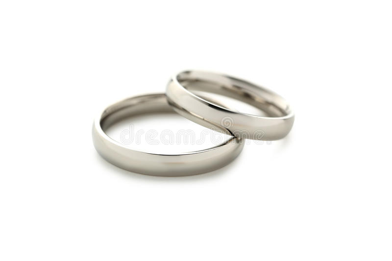 Silver wedding rings. Isolated on a white royalty free stock image