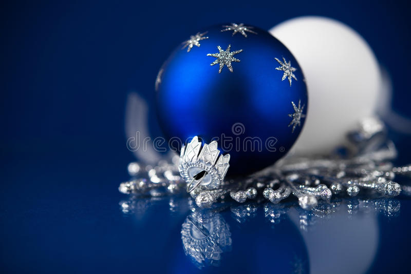 Silver, white and blue christmas ornaments on dark blue background. Merry christmas card. stock photos