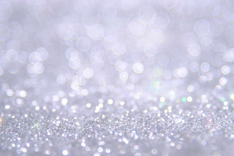 Silver and white bokeh lights defocused. abstract background stock photo
