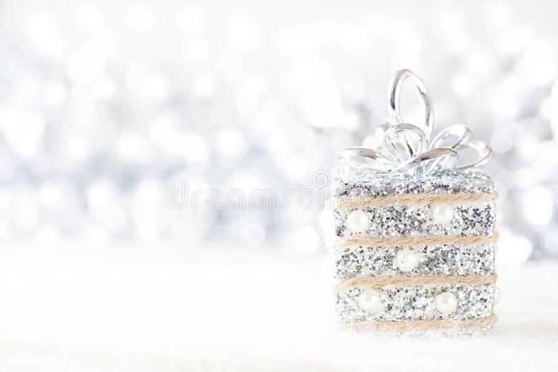 Silver and white Christmas decorations on white snow background. Space for text. royalty free stock images