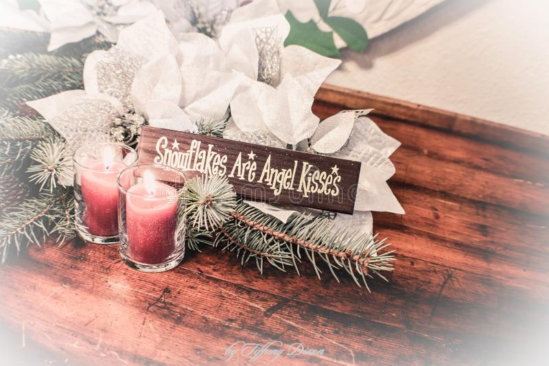 Silver and white poinsettia decorations with angel sign stock photos