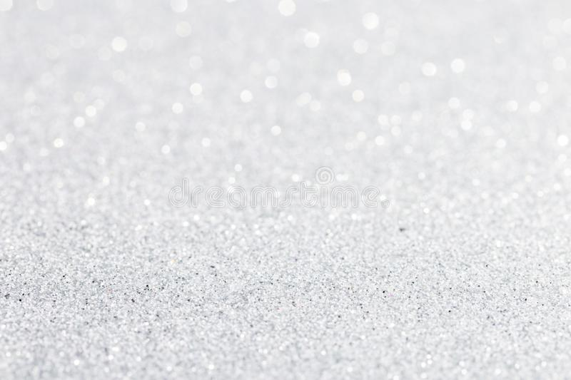 Silver white sparkle bokeh background. Abstract defocused glitter backdrop. Copy space royalty free stock images
