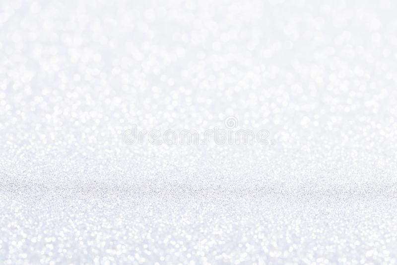 Silver white sparkle bokeh background. Abstract defocused glitter backdrop. Copy space stock image