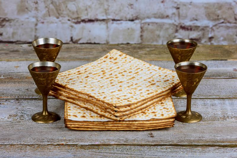 Silver wine cup with matzah, Jewish symbols for the Passover Pesach holiday. Passover concept. Jewish Matzah on Decorated Silver wine cup with matzah, Jewish royalty free stock image