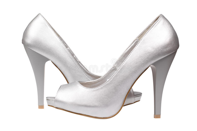 Silver women's heel shoes. A pair of silver women's heel shoes isolated over white with clipping path stock photography
