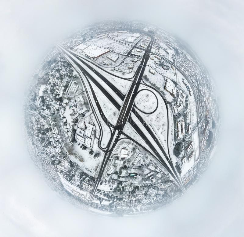 The Silver world. An image converted from the 360 by 180 aerial view of city covered by snow stock image