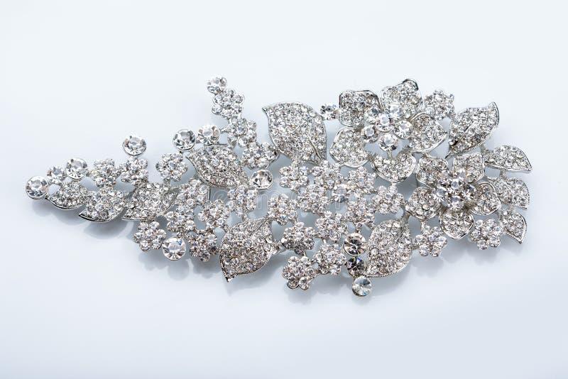 Silverbrosch med diamanter arkivfoton