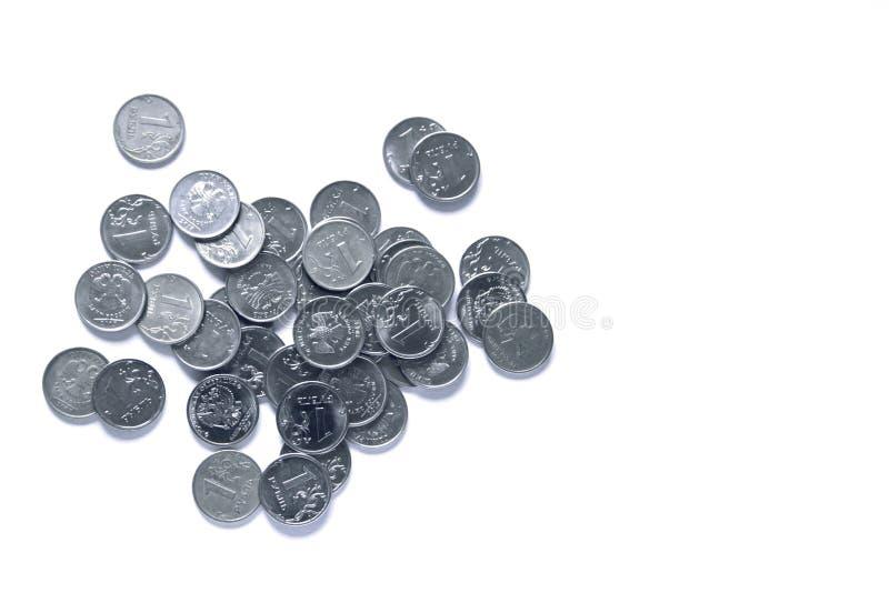 Silvermynt för en handfull arkivbild