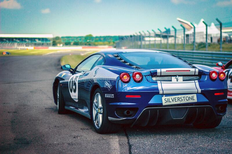 Silverstone Blue Silver Stripe Race Car on Track royalty free stock photography