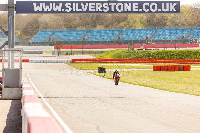 The Silverstone Sign. Silverstone, United Kingdom - April 18, 2015: On the track a sign giving the website address of the Silverstone Circuit in Northamptonshire stock photography