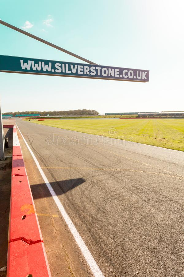 The Silverstone Sign. Silverstone, United Kingdom - April 18, 2015: On the track a sign giving the website address of the Silverstone Circuit in Northamptonshire stock photo