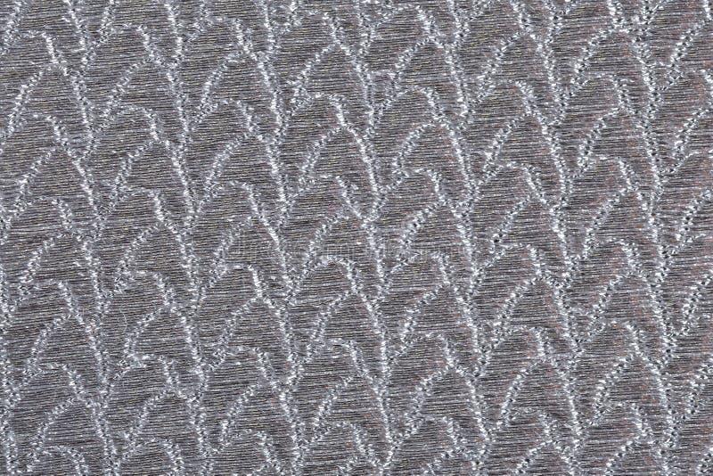 Silvertygtextur arkivfoton