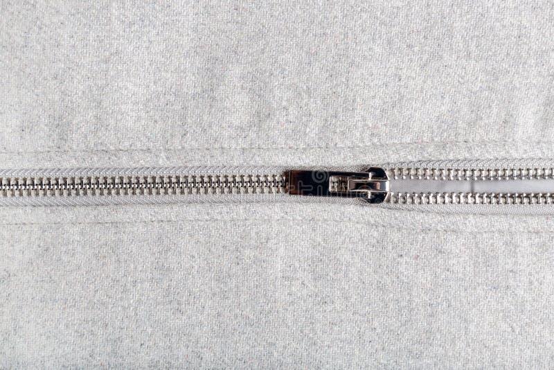 Silvervinande på woolen tyg royaltyfri foto
