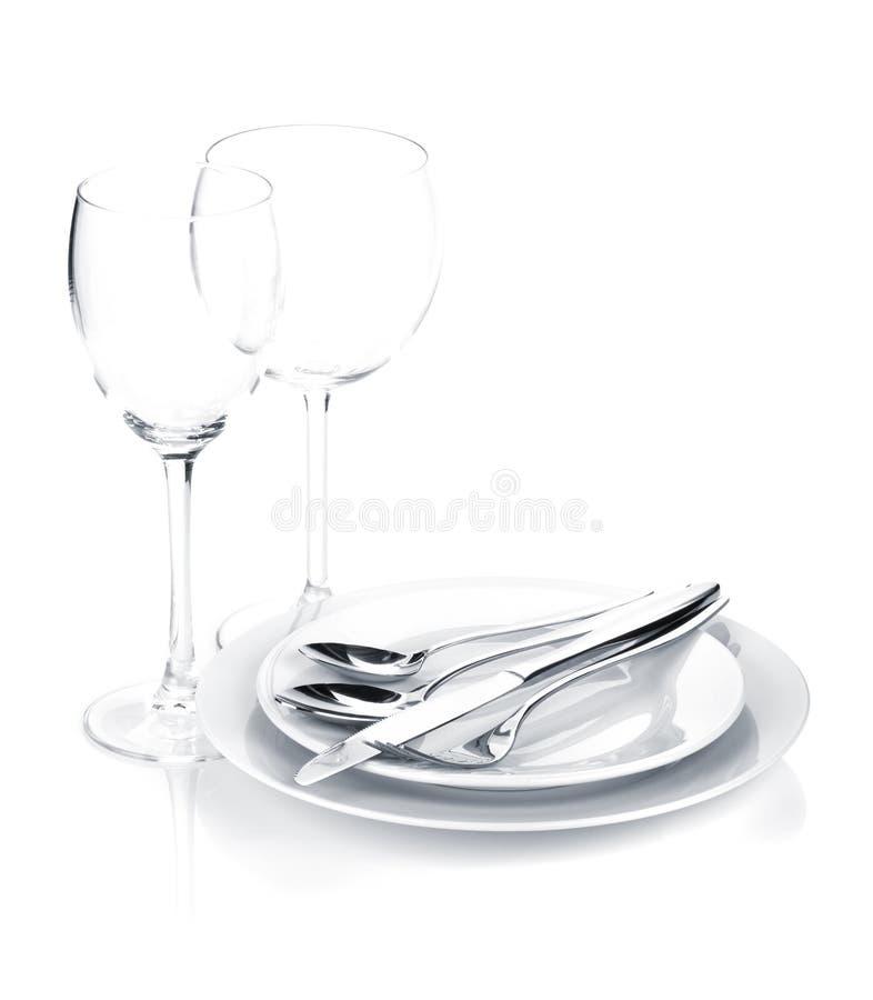 Silverware или flatware установили над плитами и бокалами стоковая фотография