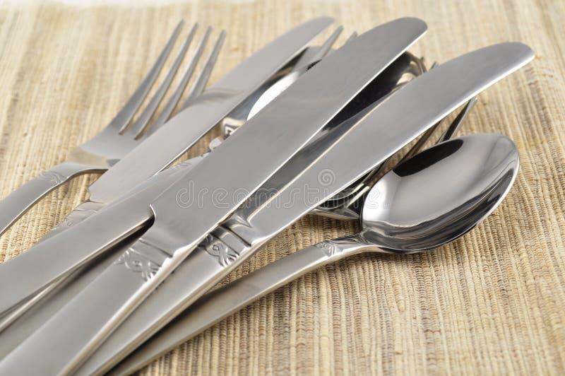 Silverware. Set of silverware on a bamboo mat royalty free stock photos