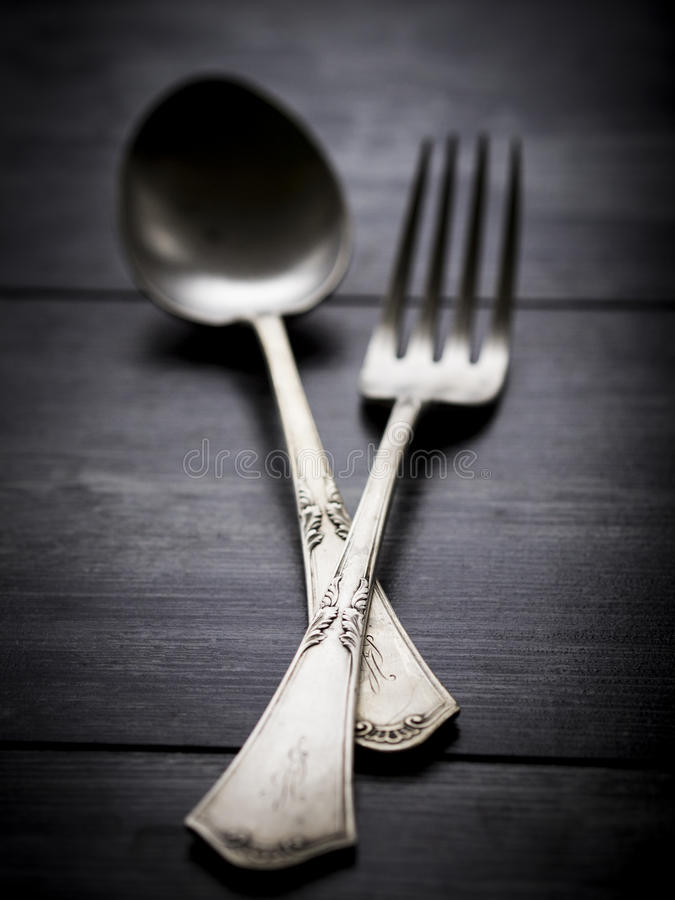 Silverware. Old rustic silverware on a wooden table stock photo