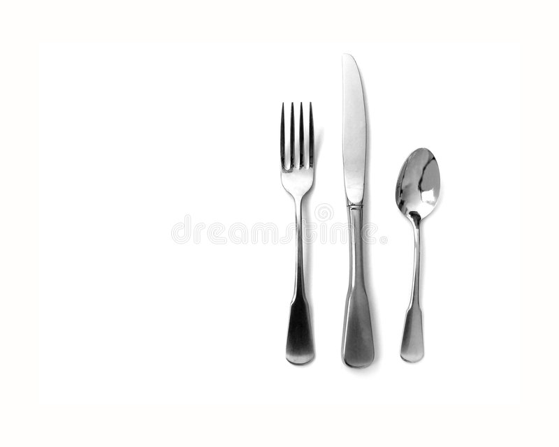 Silverware. Knife fork and spoon silverware with white background royalty free stock photos