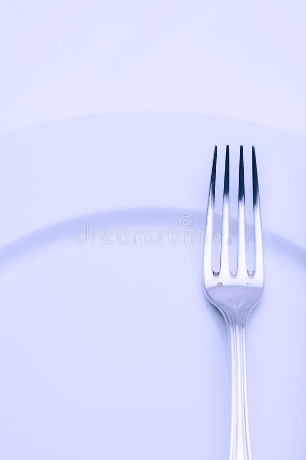 Silverware - closeup of a fork royalty free stock photography
