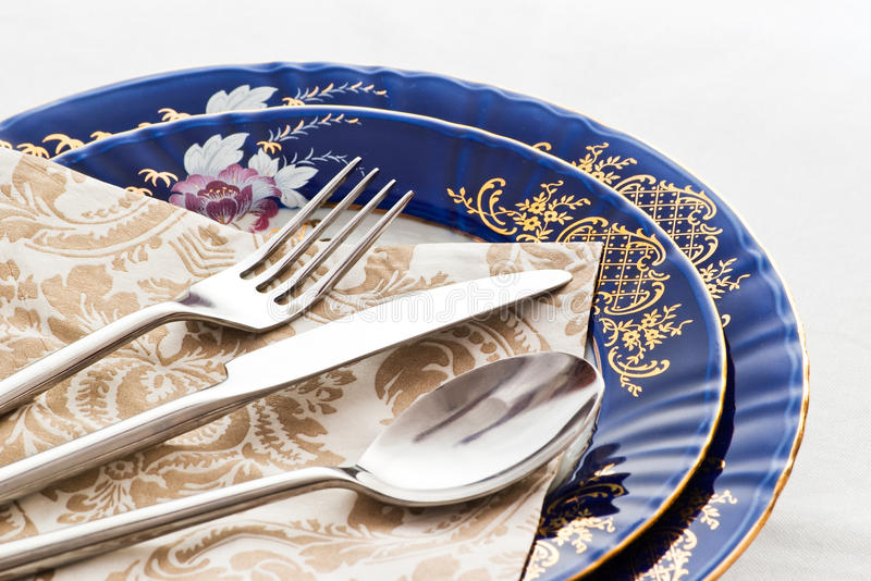 Silverware on fine porcelain stock images