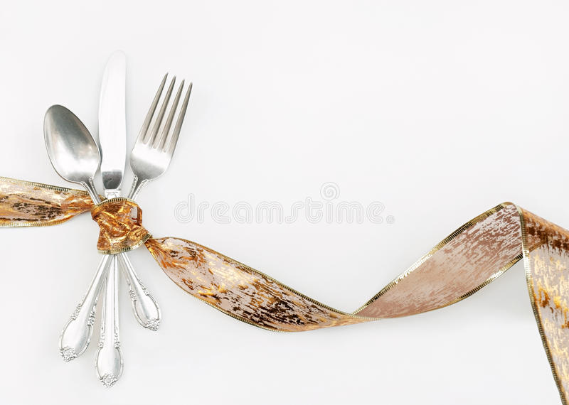 Silverware Wrapped with Holiday Ribbon royalty free stock photography