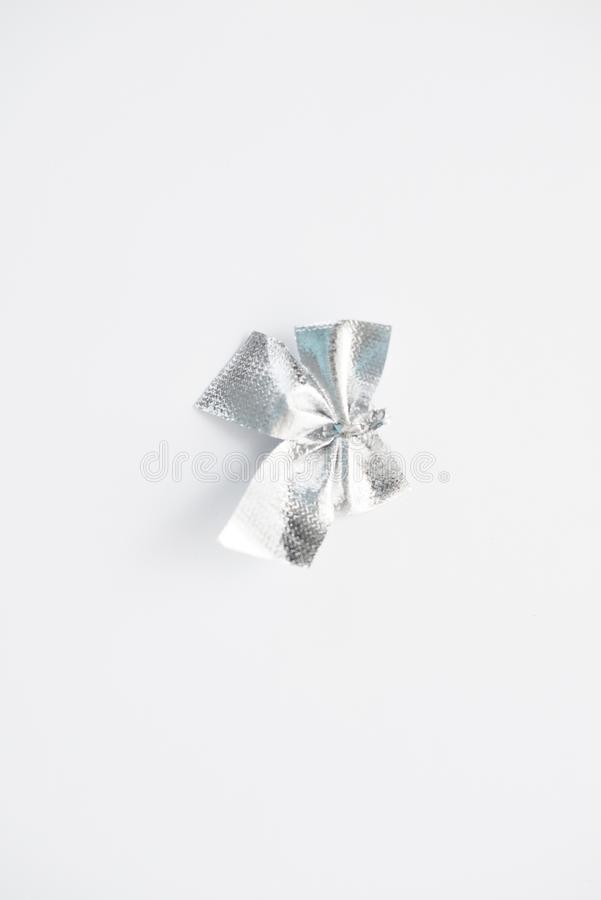 Silvery bow on a white background. Isolate royalty free stock photo