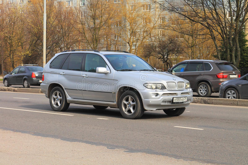 The silvery German midsize BMW X5 crossover stock photo