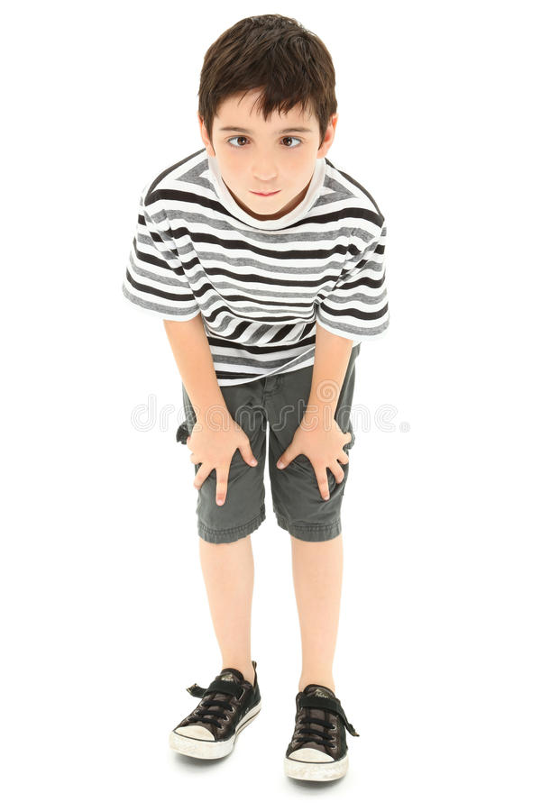 Sily Cross-eyed Silly Face Boy. Adorable 8 year old boy making silly cross-eyed face royalty free stock photography