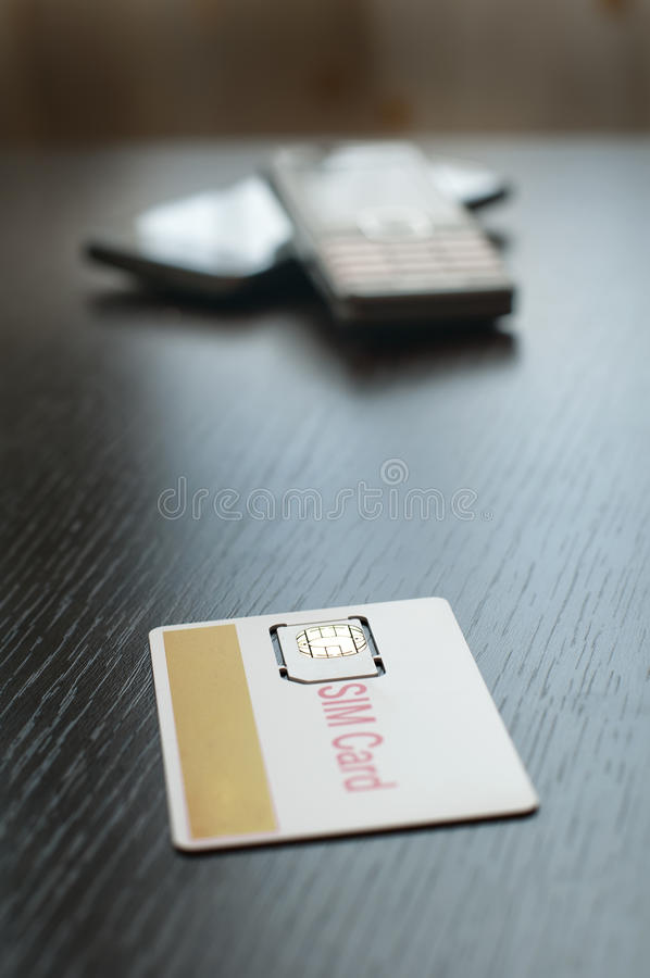 SIM card and mobile phone royalty free stock images