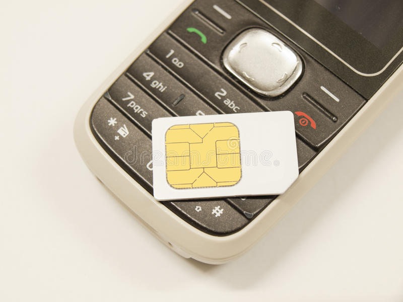 SIM card on mobile telephone royalty free stock photo