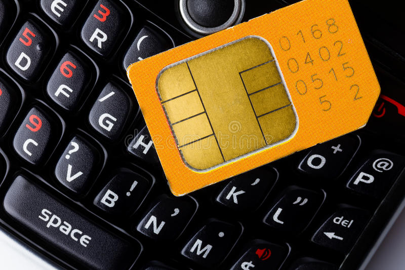 Sim card on smart phone royalty free stock photos