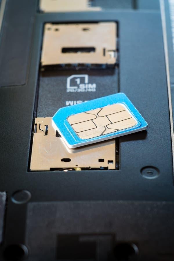 SIM card on smart phone. royalty free stock photos