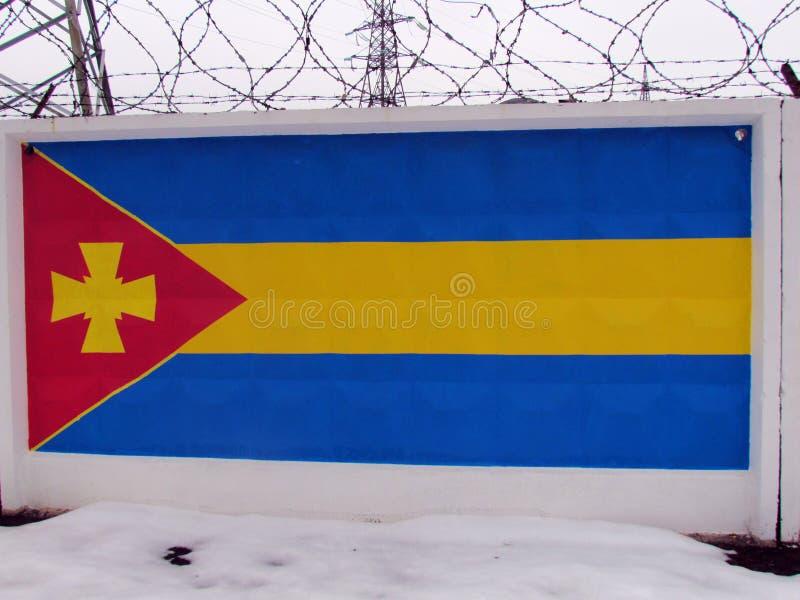 Simboli nazionali e bandiere dei distretti della regione di Poltava immagine stock