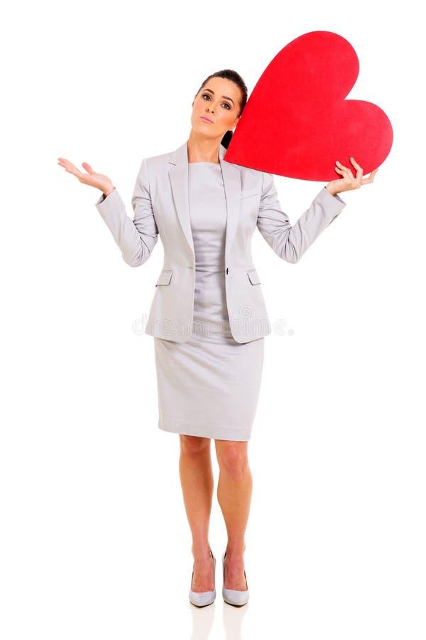 Simbolo del cuore della donna di affari immagini stock libere da diritti