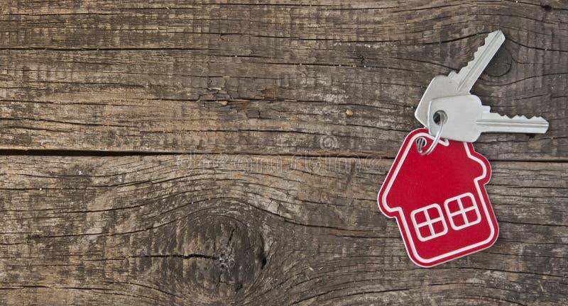 Simbolo della casa con la chiave d'argento fotografia stock
