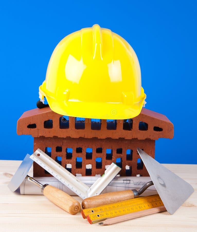 Simbolo della casa del mattone e strumenti del muratore for Costo del mattone da costruire