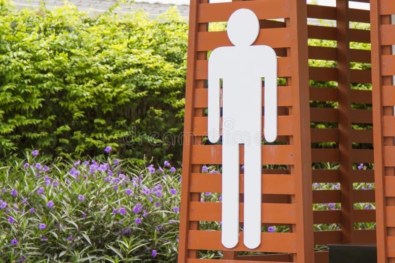 Simbolo della toilette del ` s dell'uomo bianco, fondo a strisce immagini stock
