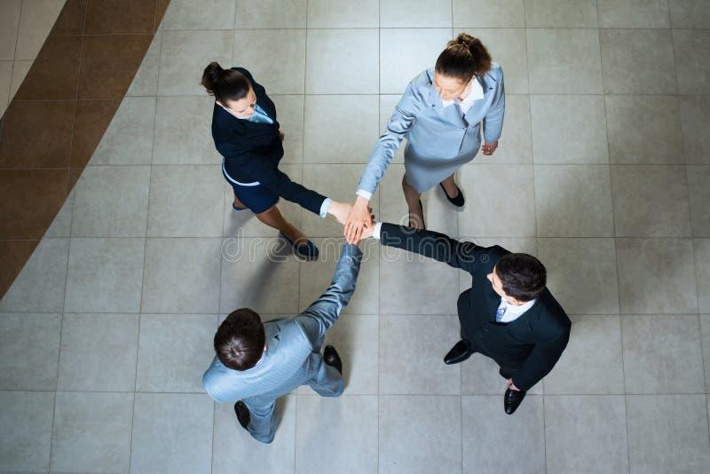 Simbolo di lavoro di squadra immagini stock libere da diritti