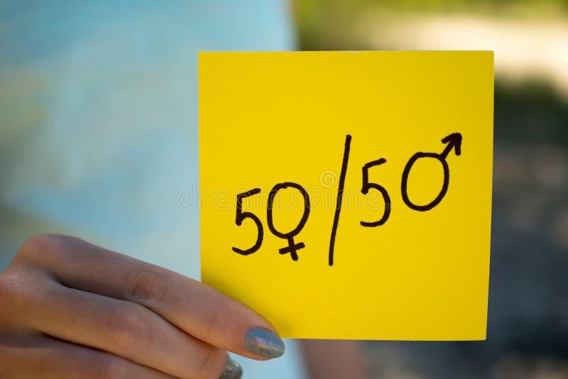Simbolo 50/50 di uguaglianza di genere immagini stock