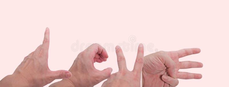 Simbolo L - O della mano - V - la E ha isolato su fondo rosa con il percorso di ritaglio immagine stock libera da diritti