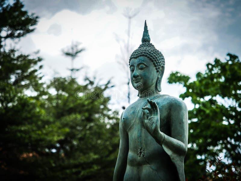 Simbolo pacifico della scultura di Buddha, segno di religione fotografia stock libera da diritti