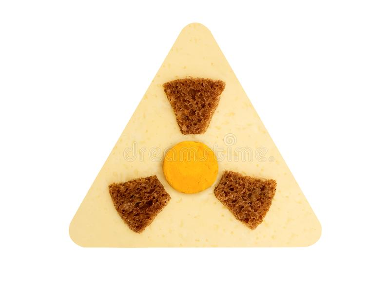 Simbolo radioattivo del pericolo di radiazione con le bande gialle e nere fatte da alimento, concetto di alimento pericoloso fotografia stock