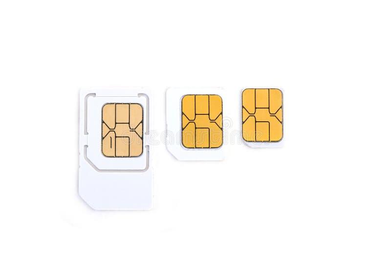 Simcard och mikrosimcard för mobiltelefon på vit bakgrund arkivfoto
