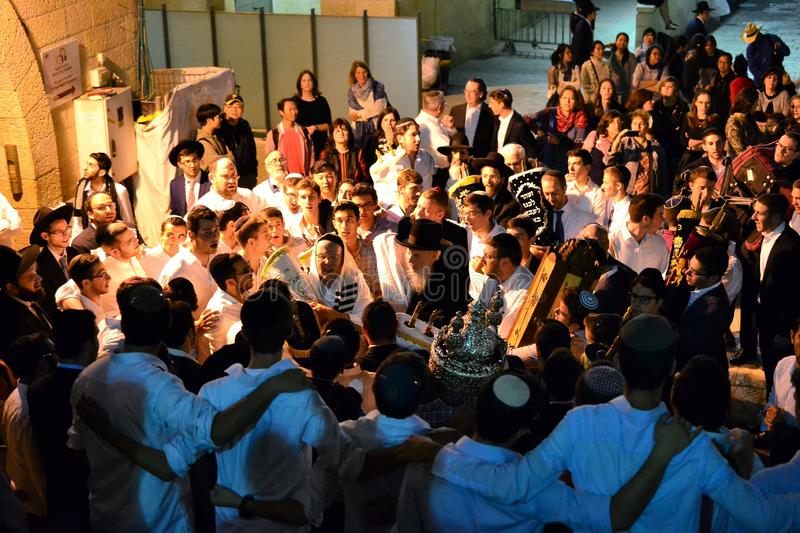Jewish people celebrating Simchat Torah at western wall in the evening royalty free stock image