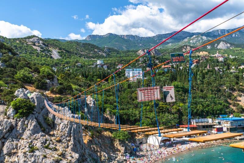 Simeiz, Crimea - July 1, 2019. Suspension bridge on top of the mountain at Diva rock royalty free stock photos
