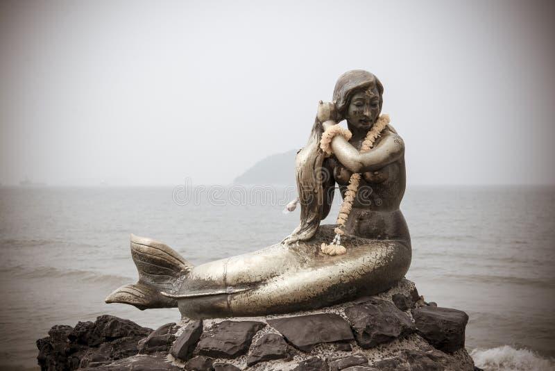 SIMILA BEACH, SONGKLA, Thailand - OCT 24: Mermaid rock monument. At Songkla beach, Thailand. (Vintage Tone stock photos